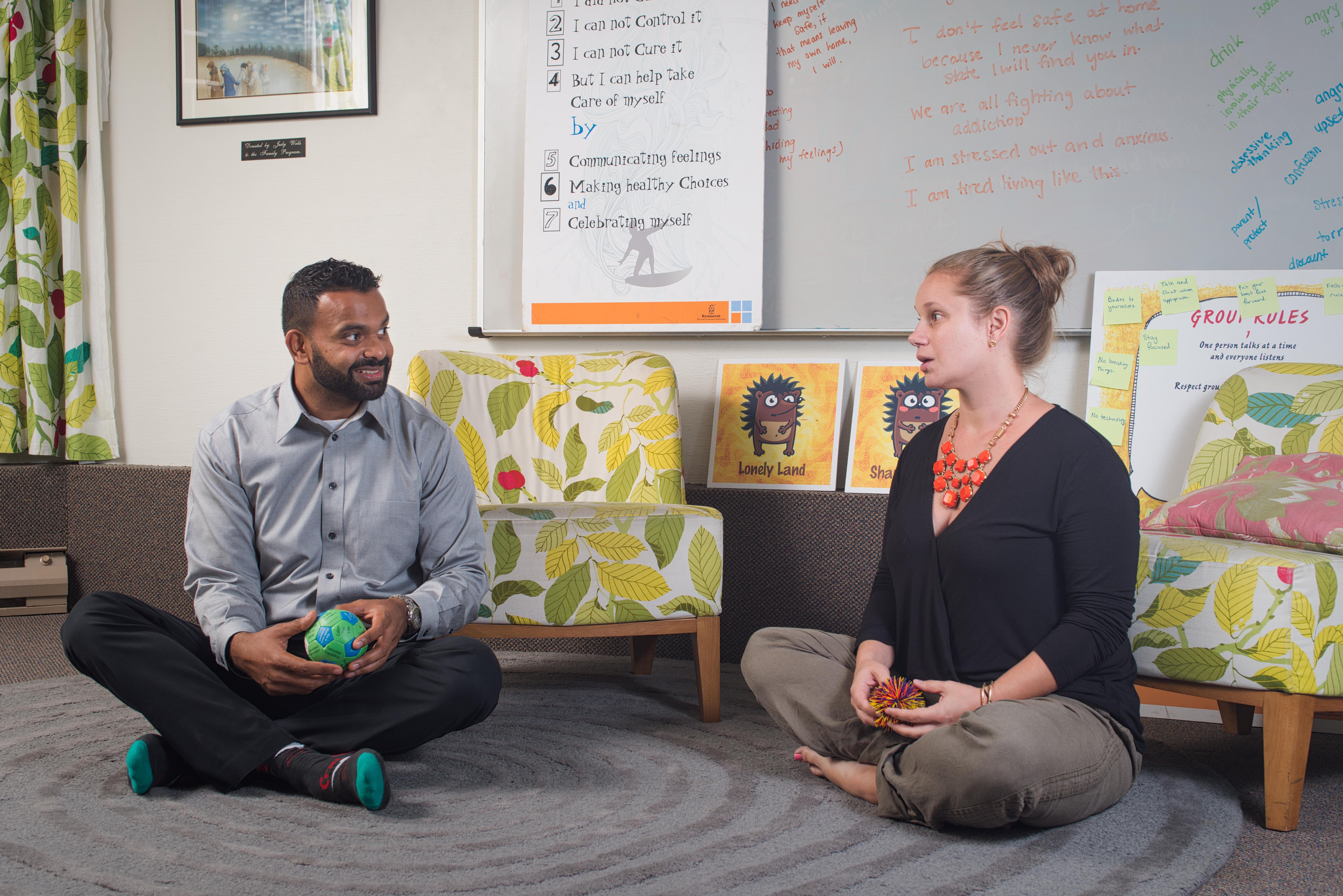 Sunil (left) and Christine (right) facilitate a Children's Healthy Coping Skills program.
